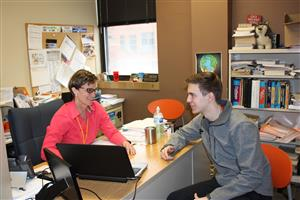 Ritenour High School college and career counselor Julie Kampschroeder talks to a student.