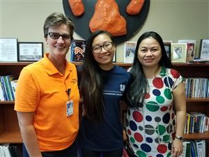 RHS College Counselor Julie Kampschroeder, Marilyn and Marilyn's Mom Anh Nguyen reunite at Ritenour High School in Aug. 2018