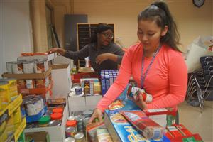 RHS students package canned goods during the 2016-2017 food drive.
