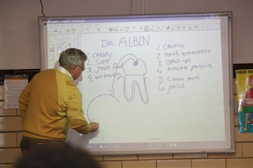 Dr. Albin volunteers in the classroom.
